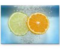 Premium Leinwandbild Limetten- und Mandarinenscheiben im Wasser