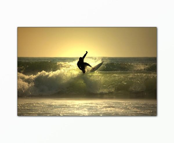 Leinwandbild Surfer bei Sonnenuntergang