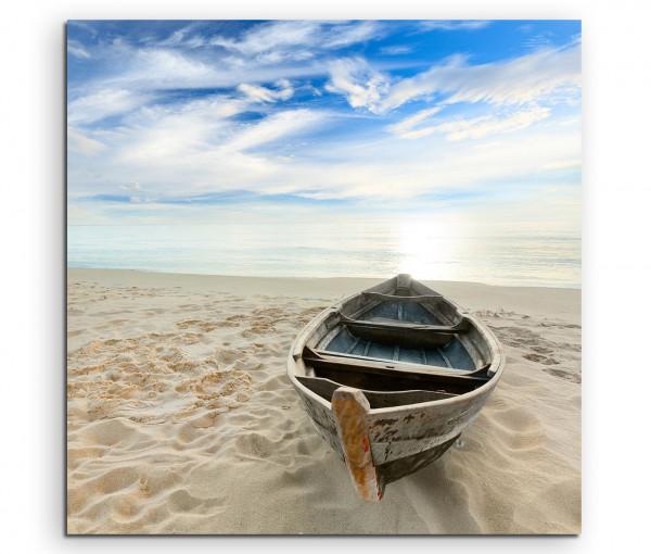 Leinwandbild Boot am Strand bei Sonnenaufgang